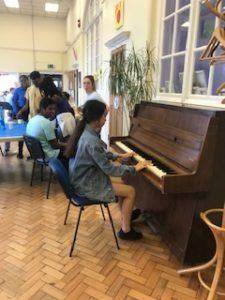 One of the NCS team playing the piano