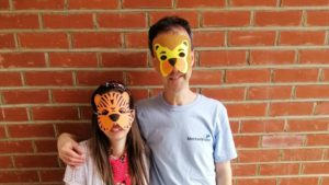 Two volunteers wearing animal masks