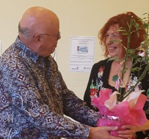 Chair of the Trustees Harry Cowd presents Penny with gifts