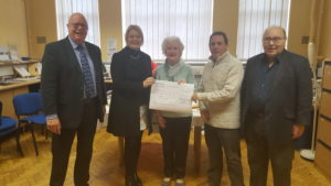 Harry Cowd chair of board of trustees, Hannah Doody Director of Social Services Merton, Bridie Alexander our lucky winner, Kevin Gregory Service manager MertonVision and Steve Moore Trustee and Treasurer.