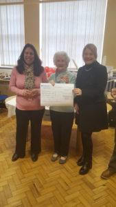 Mariza Jurgens, volunteer fundraiser, Bridie Alexander our lucky winner, Hannah Doody, Director of Social Services Merton,