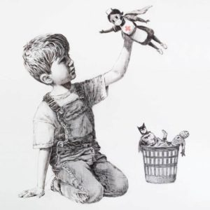 The artwork showing the boy holding up the superhero nurse doll as if she is flying