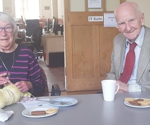 service users enjoying a hot drink and biscuits